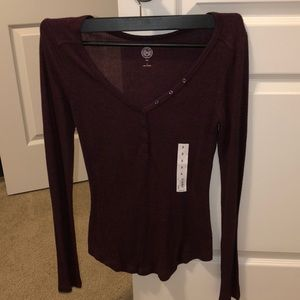 Long sleeve shirt with buttons on v neck